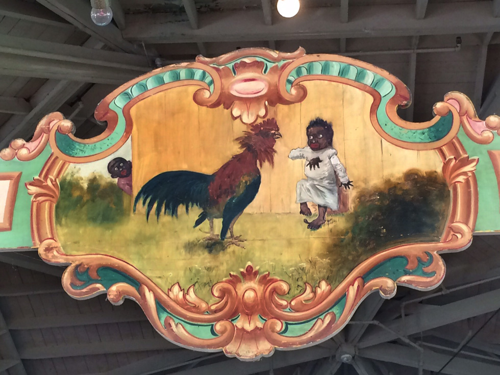 This painted picaninny panel on Rochester's Dentzel carousel has been the subject of debate since the confederate flag was removed from South Carolina's State House in July. [IMAGE: RochesterSubway.com]