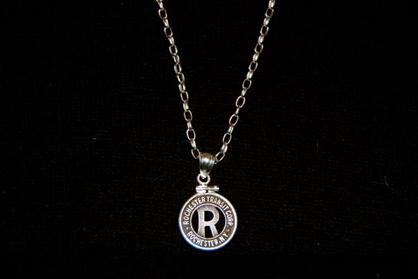 Paul Schacht bought a token from RochesterSubway.com and took it to Glen Moscoe Jewelers (S. Clinton Ave.) where, for under $50, they promptly turned it into a necklace for his daughter. Paul tells us she's a big fan of trains and the Rochester subway in particular.