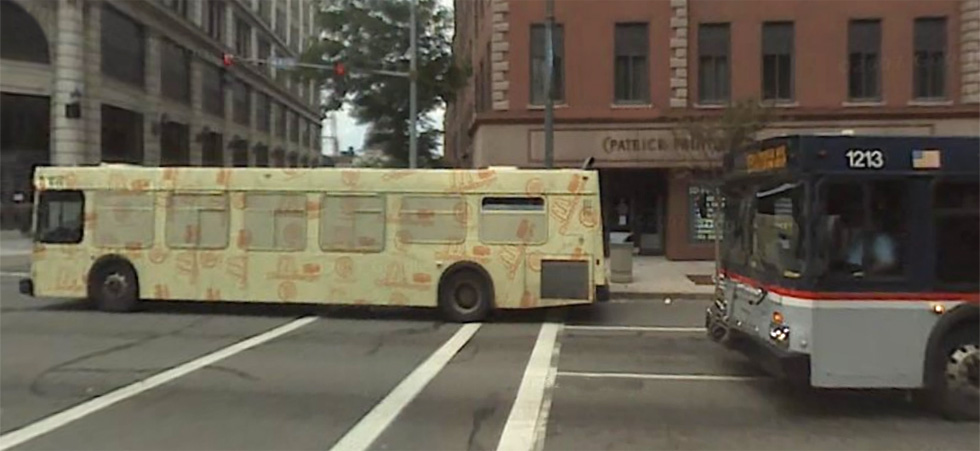 A shrink-wrapped bus advertisement on Main Street, Rochester. We asked RTS about these advertisements on behalf of one of our Facebook followers. [PHOTO: Google Maps]