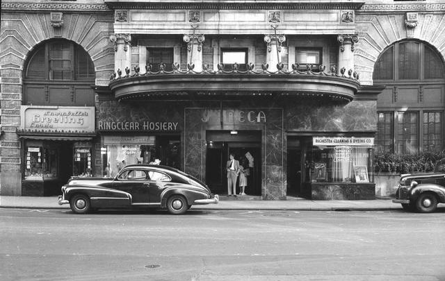 The Seneca Hotel, 26 S. Clinton Avenue, south of E. Main Street on the east side of the street. The stores in front, left to right, are Laurabelle's Greeting Cards, Ringclear Hosery Co., and Rochester Cleaning & Dyeing Co. [PHOTO: Rochester Municiple Archives]