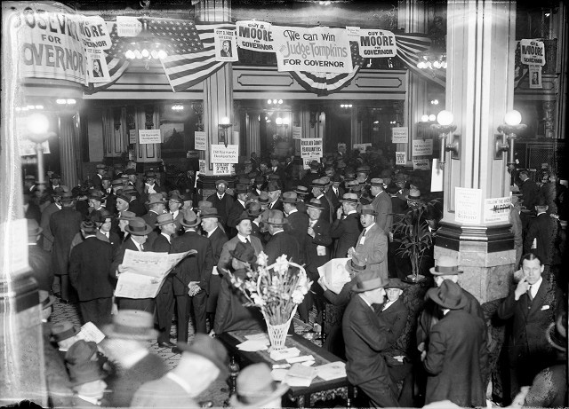 Delegates to the New York State Republican convention gather in the lobby of the Seneca Hotel. Posters show support for various candidates for nomination. c.1924 [PHOTO: Albert R. Stone Collection]