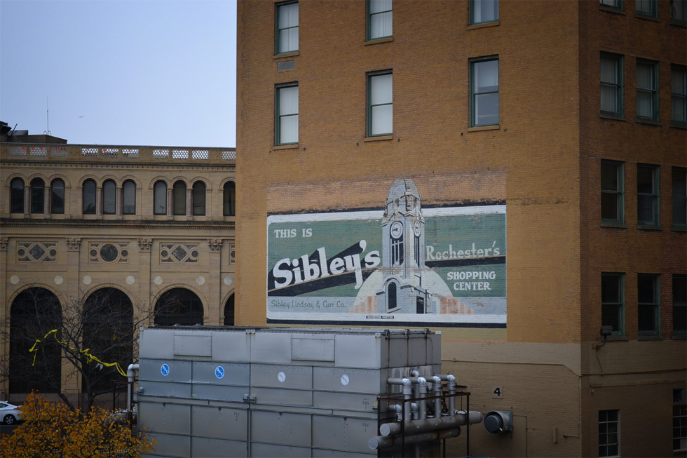 Mural billboard on the back of the Sibley's tower. [PHOTO: RochesterSubway.com]
