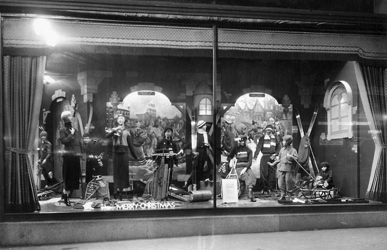 A Sibley's window display at Christmas, featuring mannequins in skiwear and showing other winter outerwear as well. 1932. [PHOTO: Rochester Public Library]