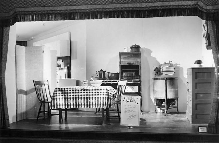 A Sibley's window display featuring an old fashioned kitchen. Note: The old fashioned kitchen and the modern kitchen were displayed side by side. 1940. [PHOTO: Rochester Public Library]