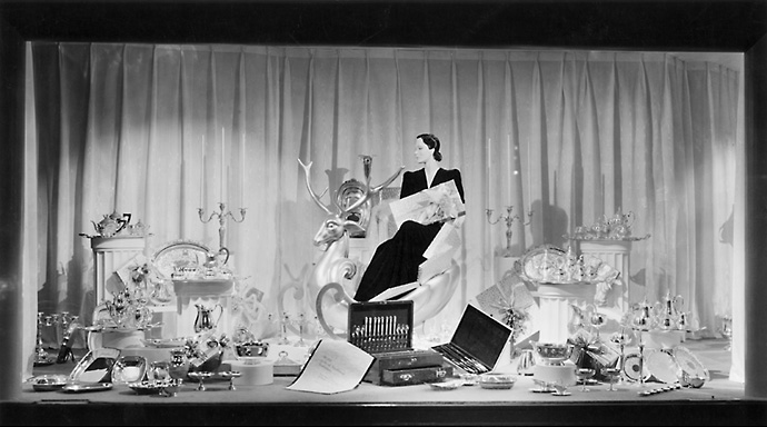 A Sibley's window display at Christmas time showing an array of silverware. 1940. [PHOTO: Rochester Public Library]