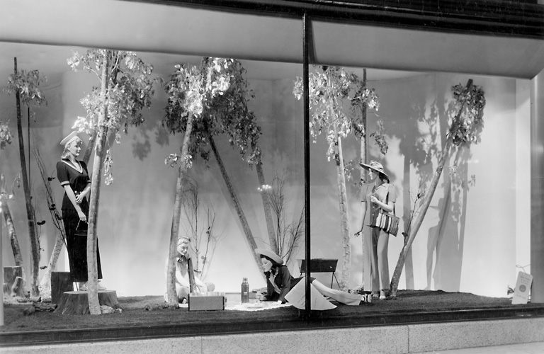 A Sibley's window display showing mannequins in fashionable clothing in a picnic setting. 1941. [PHOTO: Rochester Public Library]