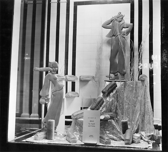 'Eat Plenty of Bread for Health and Variety. Bakery Main Floor.' A Sibley's window display featuring loaves of bread. 1941. [PHOTO: Rochester Public Library]