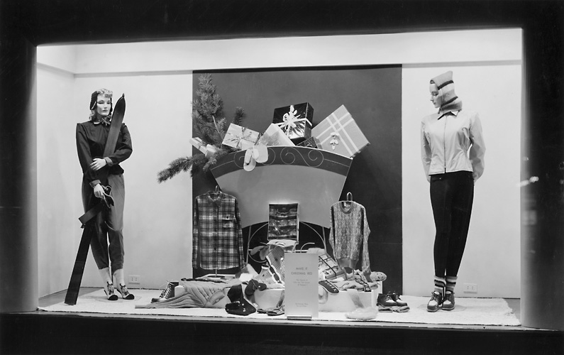 A Sibley's window display at Christmas, featuring mannequins in skiwear and showing other winter outerwear as well. 1940. [PHOTO: Rochester Public Library]