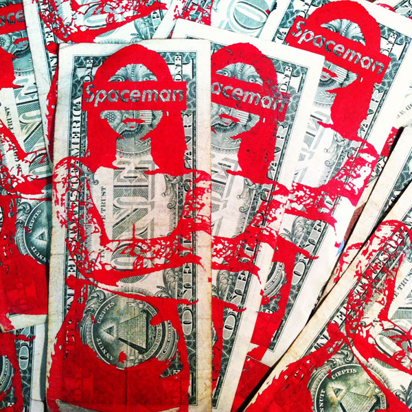 Spaceman print on dollar bills.