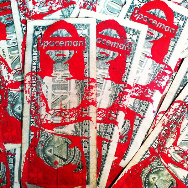 Spaceman print on dollar bills.