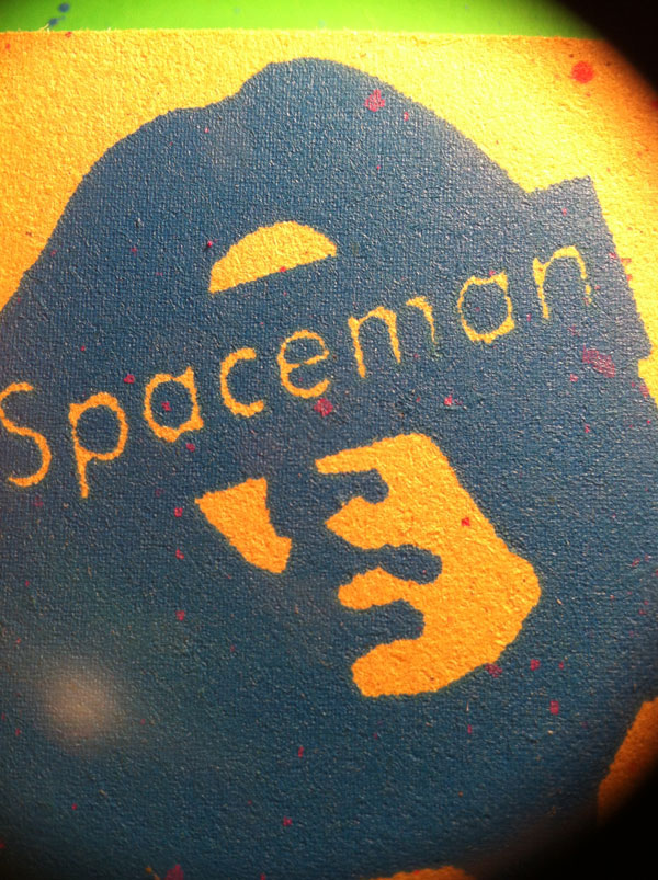 Spaceman print on yellow.