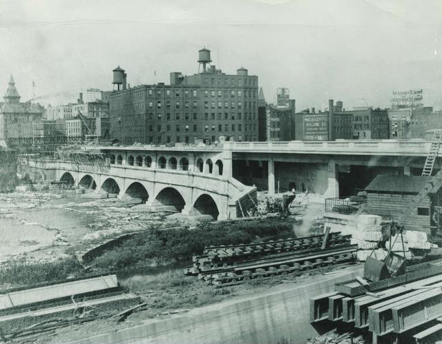 Construction of the subway bed on the Broad Street Aqueduct: some suggest this for the site of a pedestrian walkway. [PHOTO: Rochester Public Library]