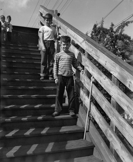Children pose on the steps of a footbridge over the Rochester Subway, just west of the Monroe Avenue Station near Adwin Place. [Image from Rochester Municipal Archives]