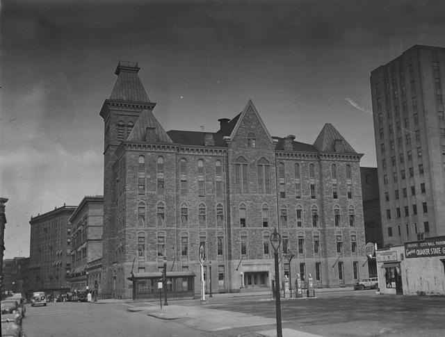 The Rochester City Hall building, as seen looking north from S. Fitzhugh Street and showing the subway entrance on Broad Street. [Image from Rochester Municipal Archives]