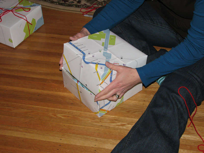 Textile artist Jennie Fox fashions gift boxes out of the Rochester Subway map. Jennie sells children's clothes and handmade accessories on Etsy.com.