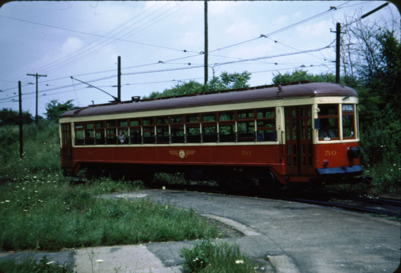 Red and cream colored Rochester Subway car 50 at Rowlands Loop, 1951.