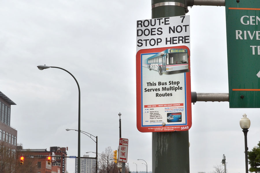 An existing RTS bus stop sign at South Avenue and Court Street. At least 14 different routes stop here. But the only thing this sign tells me is that Route 7 does not stop here. That's a problem.
