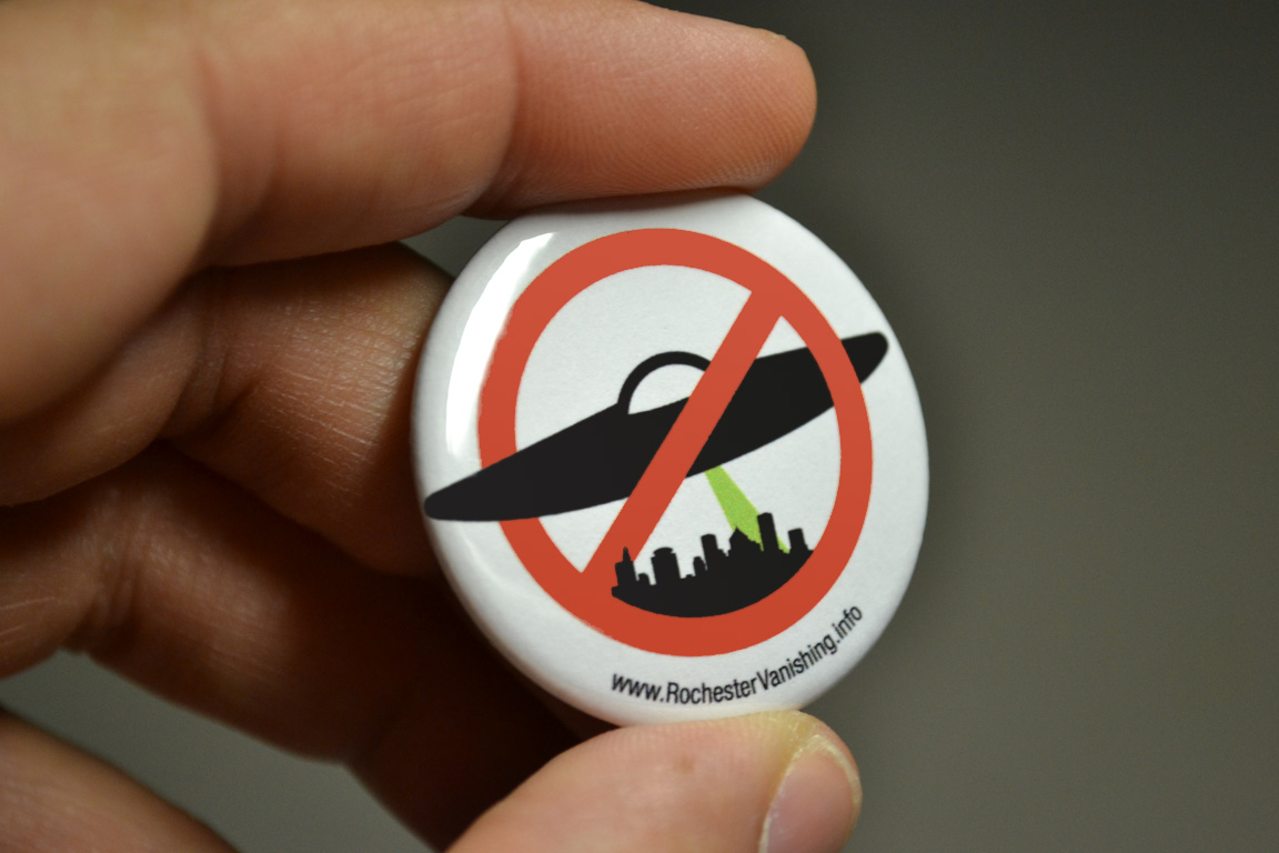 Riders with a 'UFO' pin will be able to ride local buses for free all day on October 20, the first Critical Mass Transit Day.