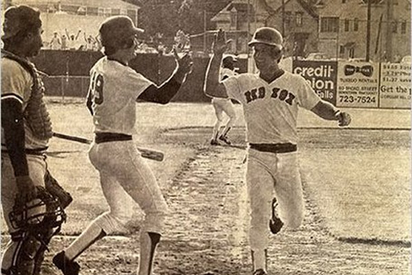 Marty Barrett scores the winning run for Pawtucket in the 33rd inning on June 23, 1981. He is greeted by Wade Boggs. [IMAGE: Associated Press]