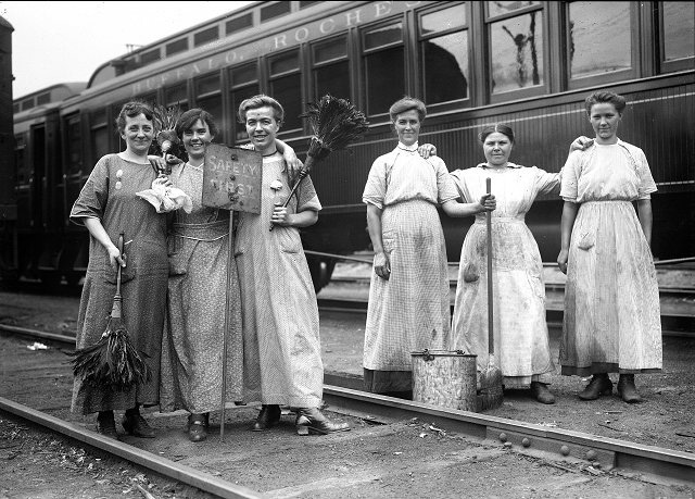 Six unidentified female railroad workers pose at Lincoln Park Station. The railroad line is the Buffalo, Rochester and Pittsburgh Railway Company. In 1917-1918, many jobs traditionally held by men were filled by women, while the men served in the Armed Services in World War I. [PHOTO: Albert R. Stone Collection]