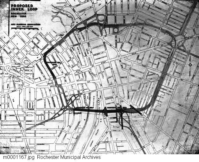 A photograph of a map showing the proposed outline for the Inner Loop. The Inner Loop was proposed in 1947 as part of the Rochester arterial plan, which also included plans for the Outer Loop and connecting expressways. The Inner Loop would be a circular highway surrounding the downtown business district and relieving traffic congestion downtown. Demolition for the Inner Loop began in 1952, and the project was completed in 1965.