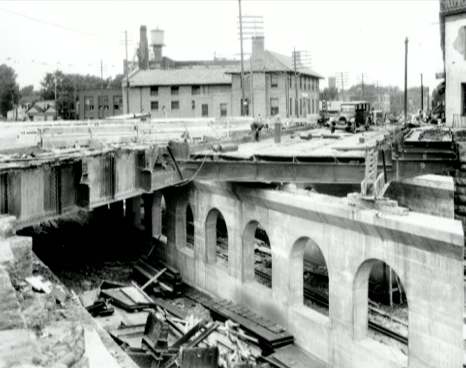 Construction of the Monroe Avenue bridge and subway entrance. Looking north with the Monroe YMCA in background.