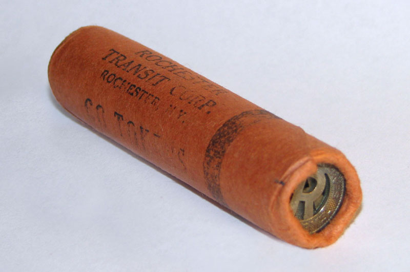 An unopened roll of New York State Railways tokens bearing the mark of the Rochester Transit Corporation.