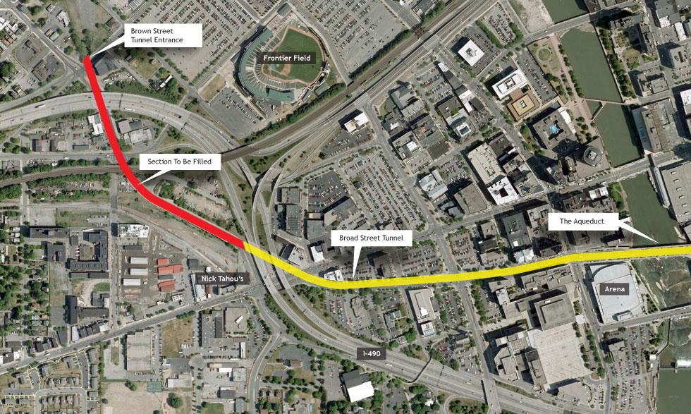 Satellite view of Broad Street in downtown Rochester. The subway tunnel is highlighted with the area to be filled marked red. Image courtesy of Google.