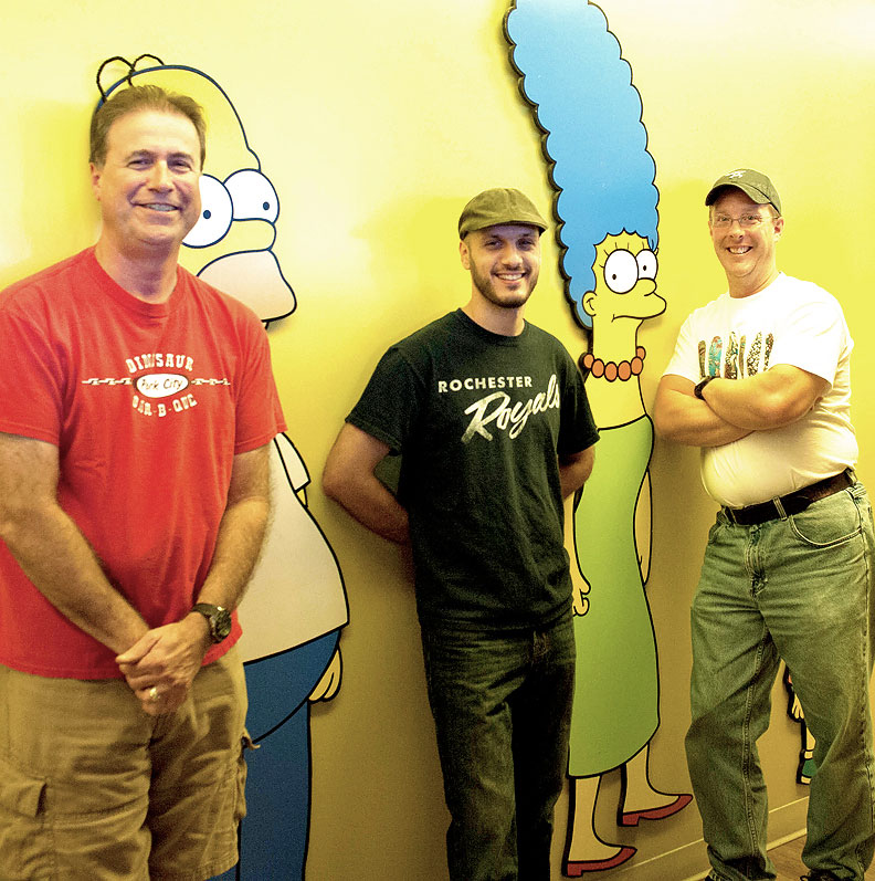 From left to right: Bill Bemiller (wife from Rochester), Mike Battle (Rochester), and Norm Auble (Spencerport) all work together on The Simpsons. [PHOTO: Brooks Stonestreet]