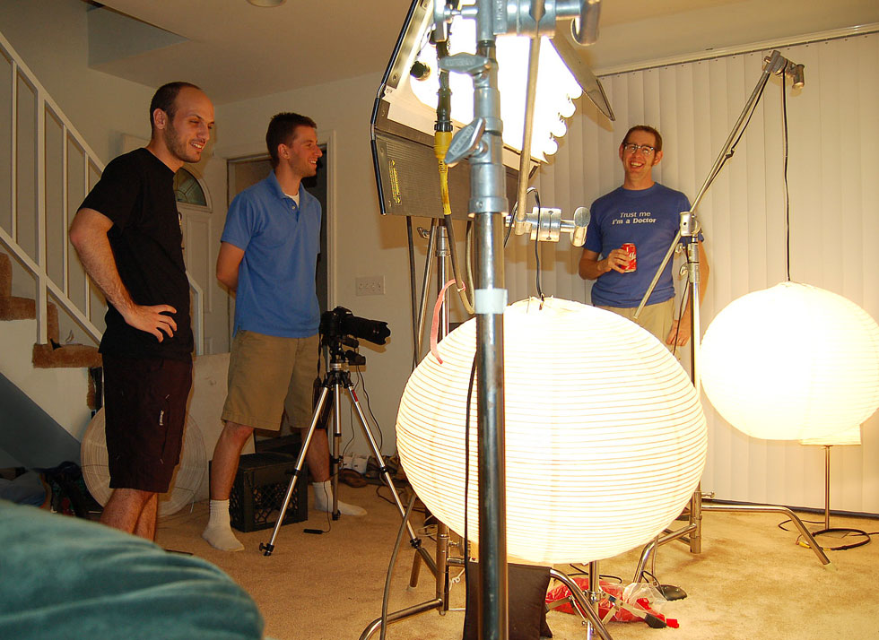 In the living room of Mike Battle's old apartment in Burbank, CA. Mike (left) with friend Scott Zarzycki, and P.J. Gaynard shooting The Simpsons LEGO couch gag. [PHOTO: Patrick Garney]