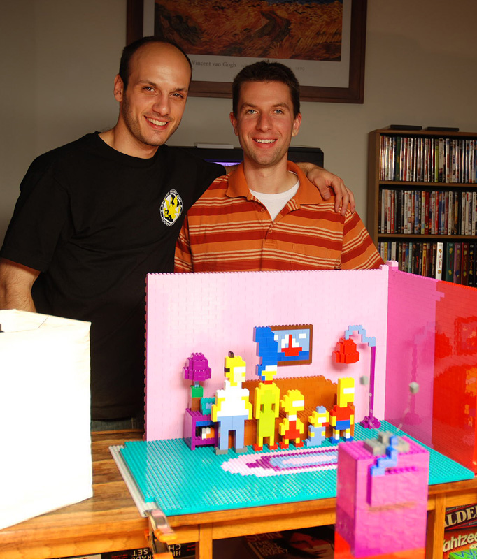 Mike Battle and friend Scott Zarzycki together with The Simpsons LEGO couch gag set.