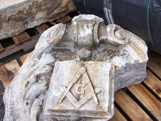 A stone from the Masonic Temple that once stood at Clinton Avenue and Mortimer Street. [IMAGE: RGRTA via Democrat & Chronicle]