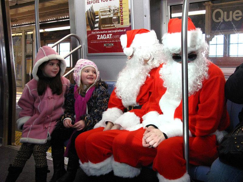 Subway Santas [Flickr Photo: t_a_i_s]