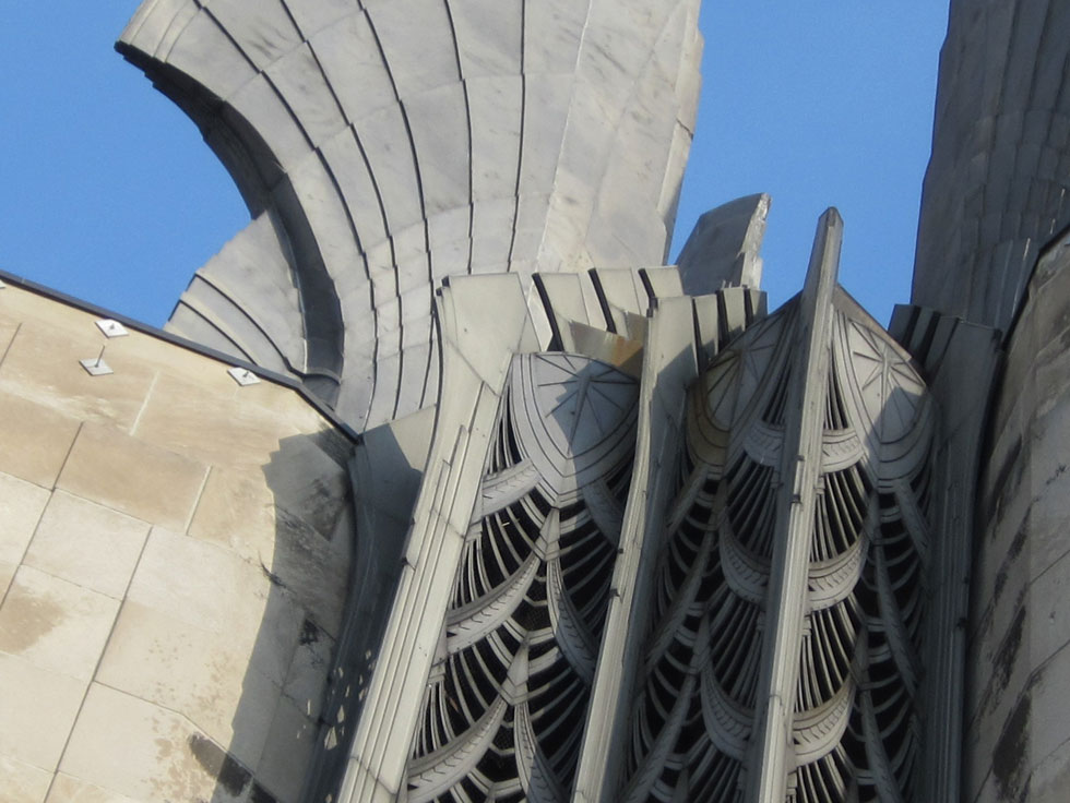 The most distinctive feature of this 260-foot tall building are those large cast aluminum wings, known as the 'wings of progress, symbolizing the age of aviation. The screen below is decorated with a wheat motif - symbolizing prosperity, it's a recurring theme in and around the building. [PHOTO: Ryan Green]