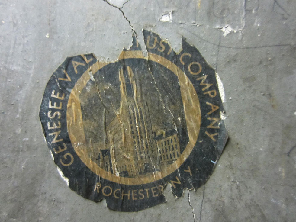 A Genesee Valley Trust Company sticker. GVT was the building's original occupant. They moved out in 1955. [PHOTO: Ryan Green]