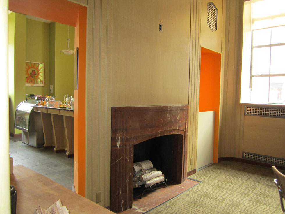 There's now an Orange Glory Cafe on the first floor. This fireplace was discovered hiding under drywall. [PHOTO: Ryan Green]