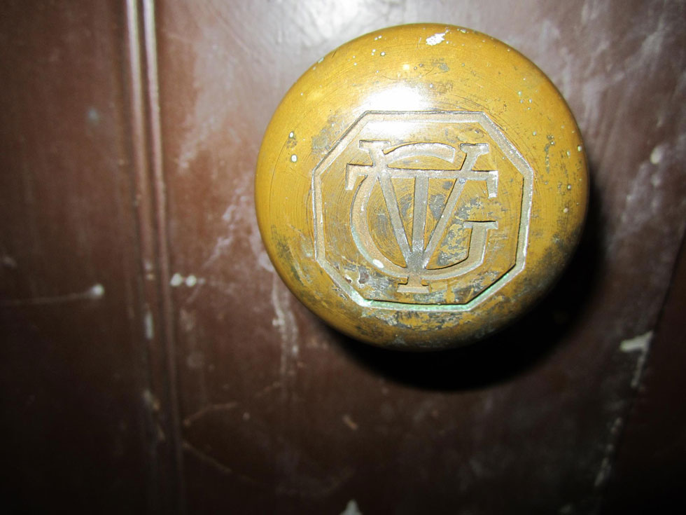 A doorknob with the letters GVT-Genesee Valley Trust. [PHOTO: Ryan Green]