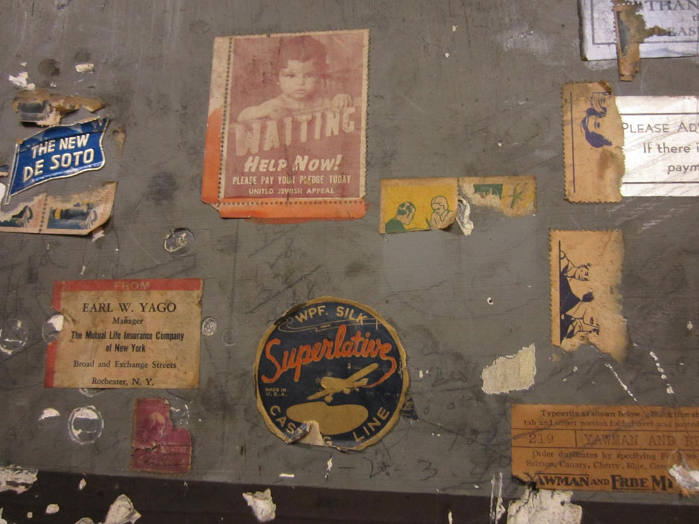 Vintage stickers and stamps adorn the walls. [PHOTO: Ryan Green]