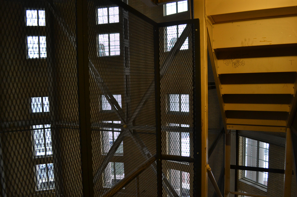 After a 10-or-so-story elevator ride we're dropped into a steel cage enclosed stair case located inside the giant rotunda. [PHOTO: RochesterSubway.com]