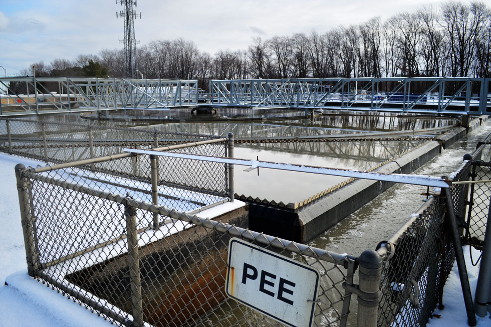 PEE and PEW? PEE stands for Primary Effluent East. The tanks on the other side are PEW; Primary Effluent West. Effluent is liquid waste. [PHOTO: RochesterSubway.com]