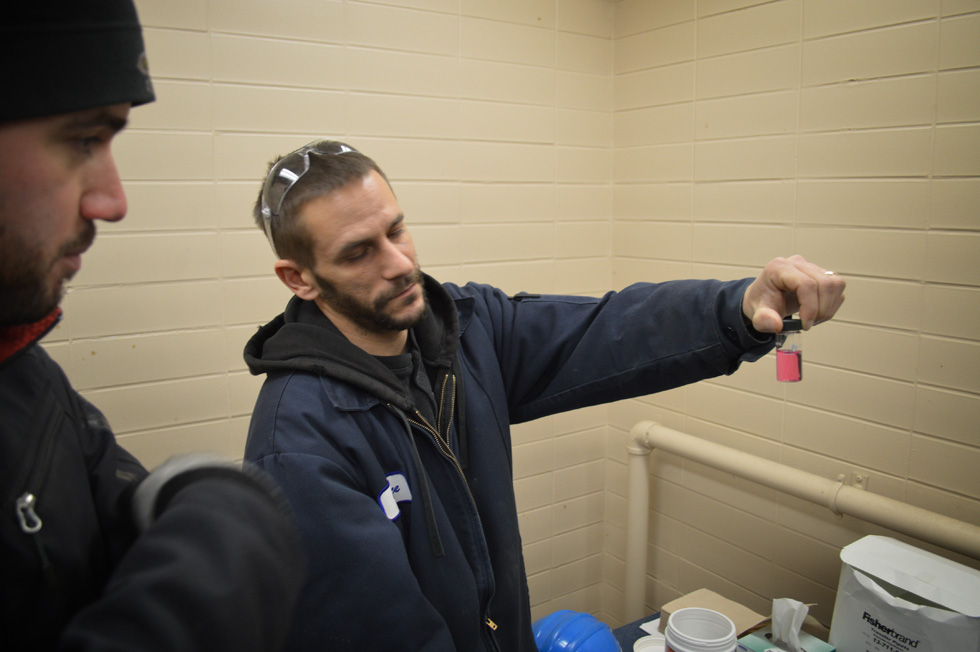 Here, facility operators run Chlorine residual tests 24/7 to verify that the disinfecting dose of Sodium hypochlorite is just right. Pink = Good. [PHOTO: RochesterSubway.com]