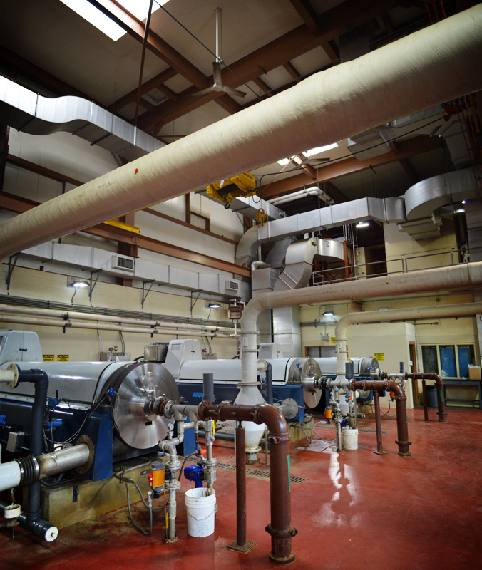 Ok, now we come to a room with several big, multi million dollar centrifuges. The sludge is pumped in and spun around real fast so as to squeeze out any remaining drops of water that haven't already been removed.  [PHOTO: RochesterSubway.com]