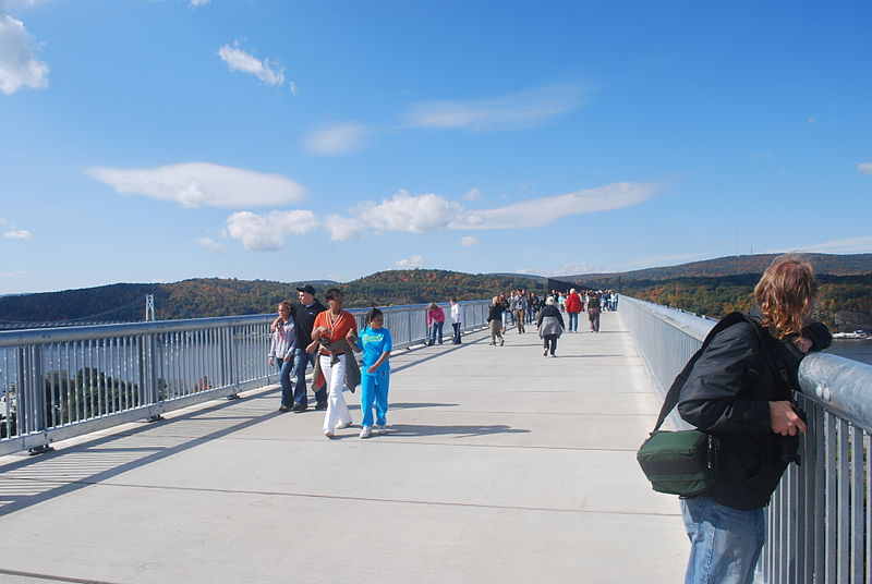 The old rail bridge could be converted to a pedestrian bridge similar to this walkway over the Hudson River. [PHOTO: Julian Colton, Wikimedia Commons]
