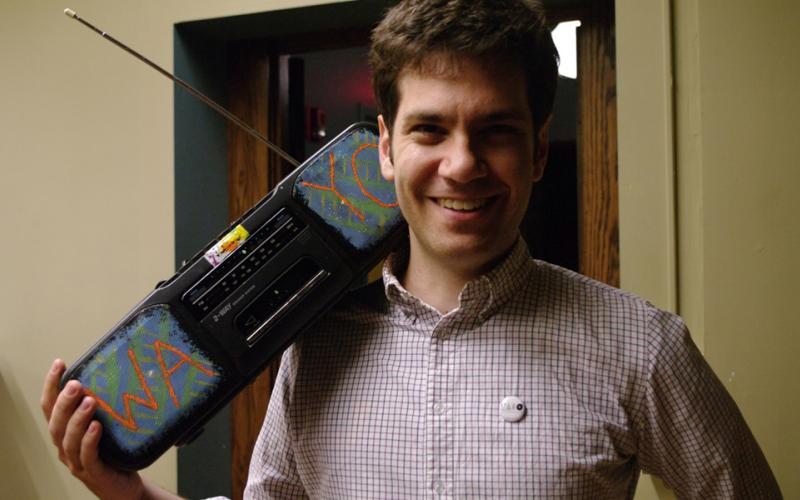 Mike Yates with the infamous WAYO Boombox. [PHOTO: wayofm.org]