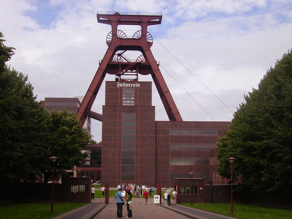 The Zollverein Coal Mine Industrial Complex (German Zeche Zollverein) is a large former industrial site in the city of Essen, North Rhine-Westphalia, Germany. It has been inscribed into the UNESCO list of World Heritage Sites since December 14, 2001 and is one of the anchor points of the European Route of Industrial Heritage. [Wiki Photo: Zairon]