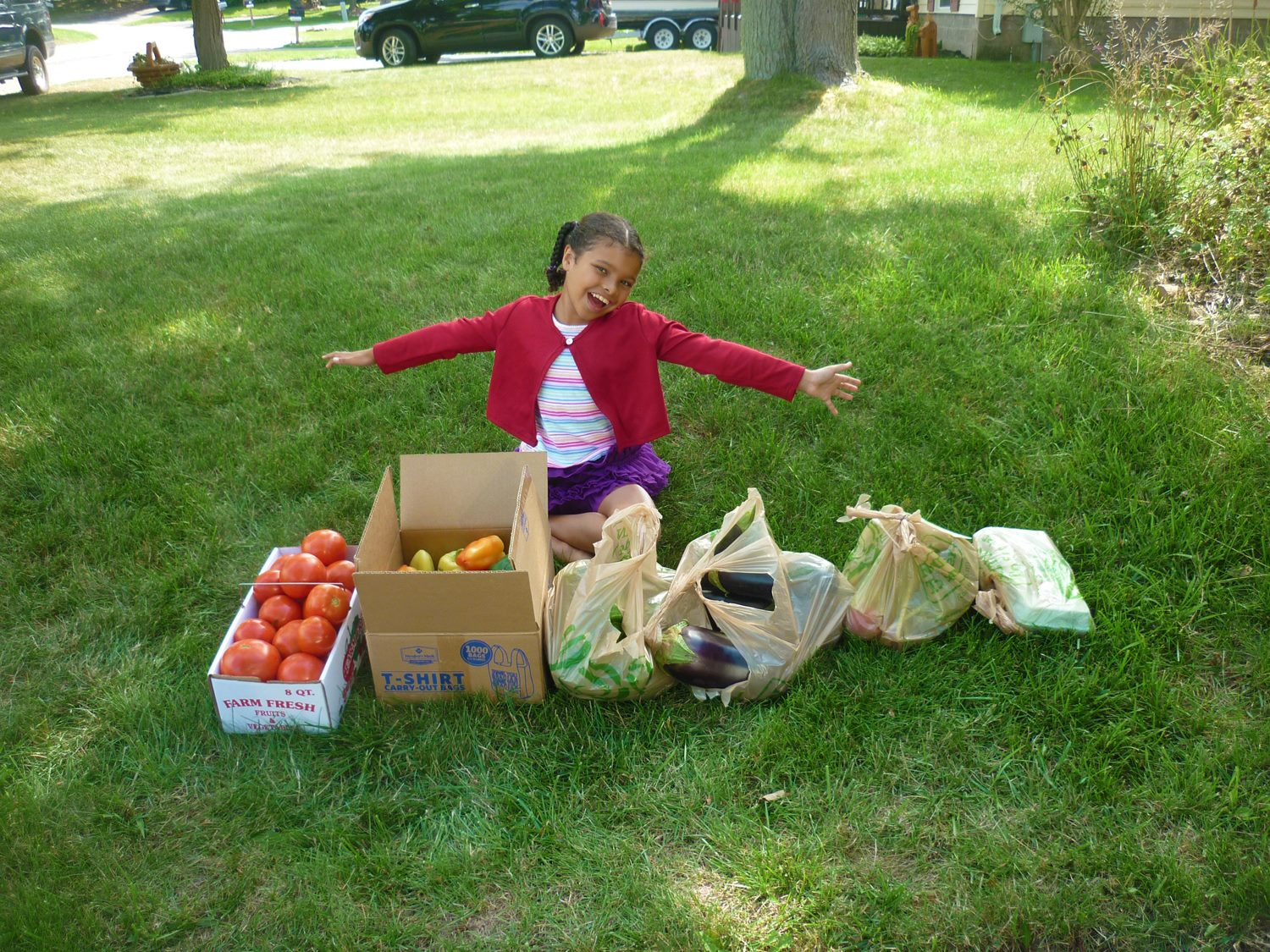 Gloria with late August bounty [PHOTO: Gloria Grattan]